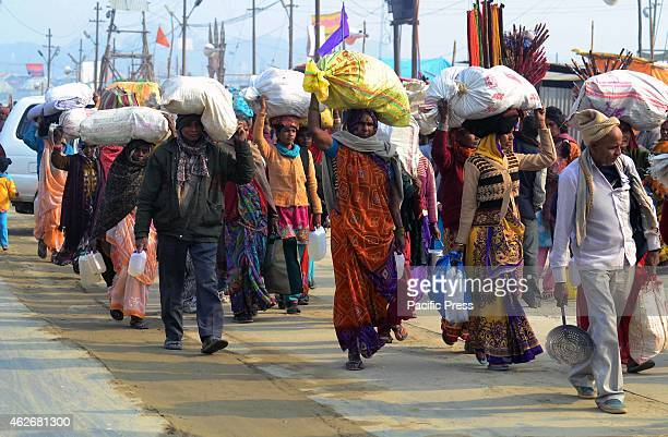 Devotees arrive at Sangam to take holydip on the eve of Maghi Purnima festival during one month long Magh mela festival