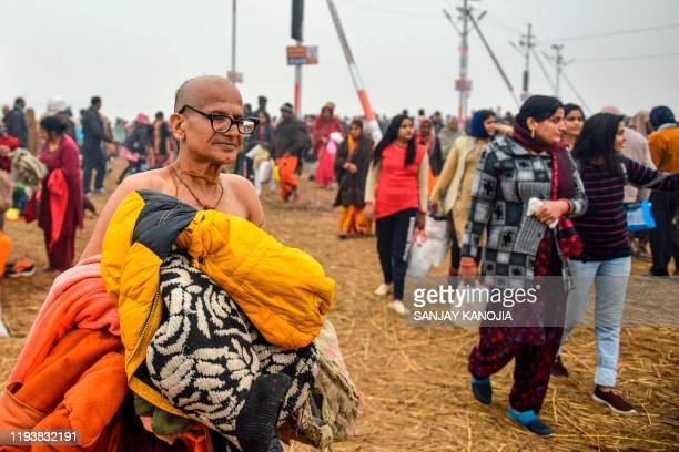 Devotees arrive to take a holy dip on the occasion of the Makar Sankranti festival during the annual Hindu 'Magh Mela' festival at Sangam -- the...