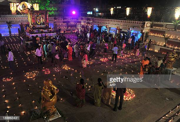 Devotees at a temple for the Hindu God Shiva take part in a Karthigai Deepam a festival where they light oil wick lamps at the temple pond in...