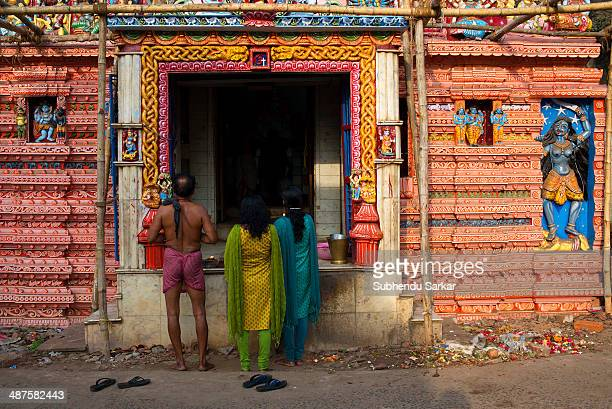 Devotees at a temple in Puri Puri a city in Odisha in India is situated on the Bay of Bengal It is famous for the 11th century Jagannath Temple It is...