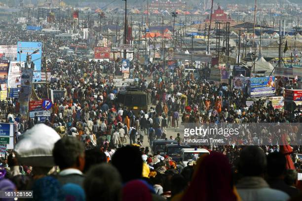 Devotees at large numbers arrive at Kumbh mela area on February 9, 2013 in Allahabad, India. The mega religious fair is held once in 12 years in...