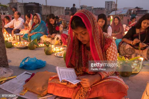 Devotees attend prayer with burning incense and lit oil lamps before breaking fast during a religious festival called Rakher Upobash or Kartik Brati...
