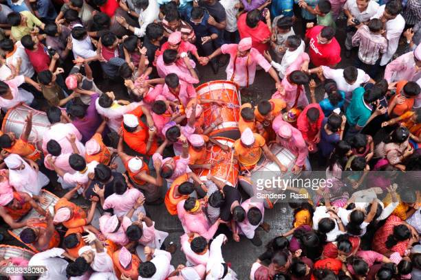 Devotees beating dhol as Ganesh Idol carried for immersion