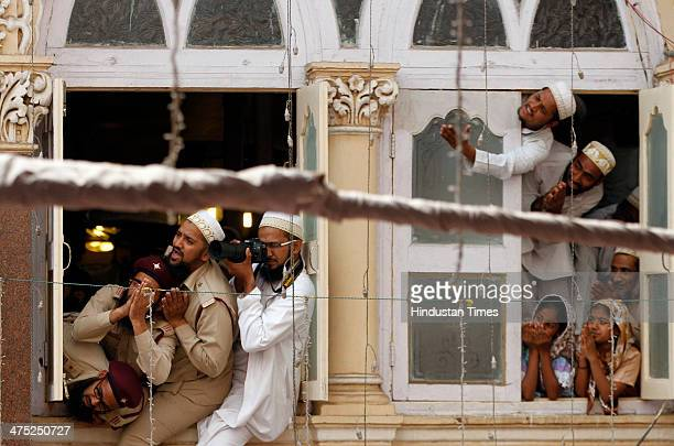 Devotees belonging to the Dawoodi Bohra Muslim community take part in a final prayer after 40 days mourning period ended after Syedna Mohammed...