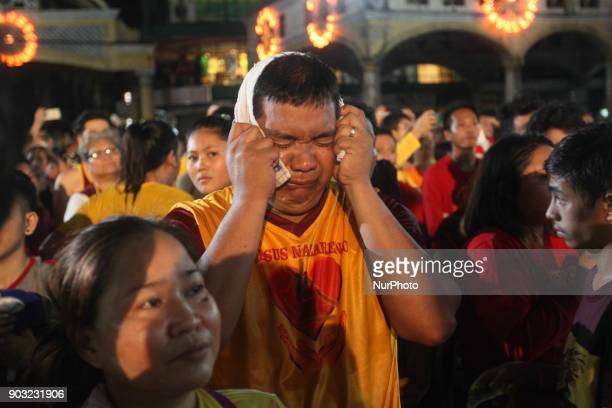 Devotees break into tears after the image of the Black Nazarene was successfully brought back inside the Quiapo Church in Manila early morning of 10...