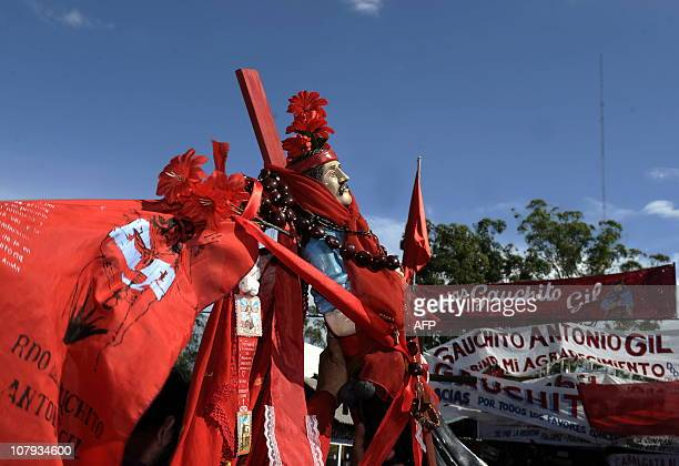 Devotees carrie folk saint Gauchito Gil's image outside his sanctuary near Mercedes in the Argentine province of Corrientes on January 8 2011 The...