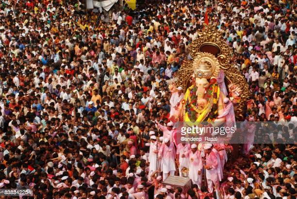Devotees carry Ganesh Idol for immersion