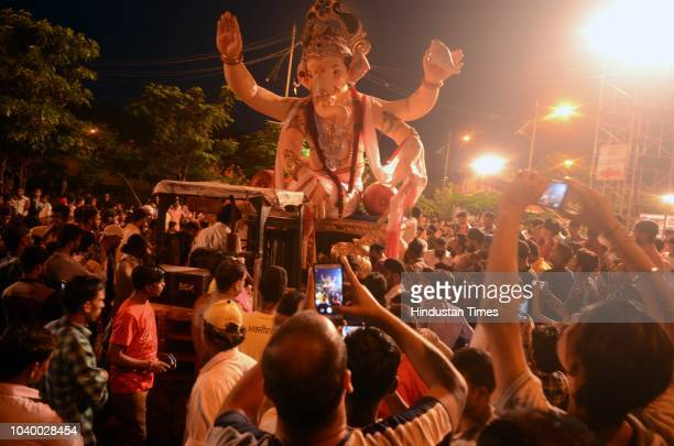 Tribal artists from Universal tribes perform in Immersion procession of Seva Mitra Mandal on the last day of Ganesh Chaturthi festival at Tilak Road...