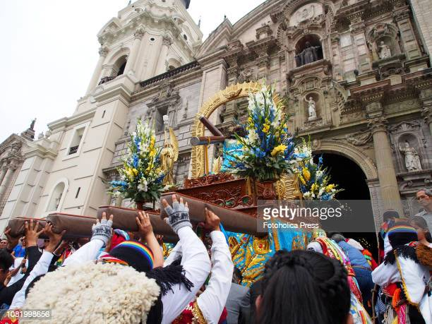 Devotees carrying a religious litter when hundreds of Quechuaspeaking Indigenous people devotees of San Sebastian carry on a religious procession to...