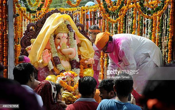 Devotees carrying an idol of Hindu Lord Ganesha to immerse at Damdama Lake on the last day of the Ganesh Chaturthi festival on September 27 2015 in...