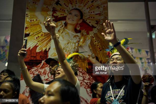 Devotees carrying an image of the Holy Child Jesus as they pray and dance during the annual Sinulog festival on January 18 2020 in Cebu Philippines...