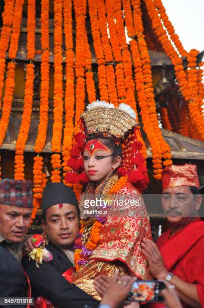 Devotees carrying Goddess 'Kumari' for the chariot pulling festival on the last day of Indra Jatra Festival celebrated in Basantapur Durbar Square...
