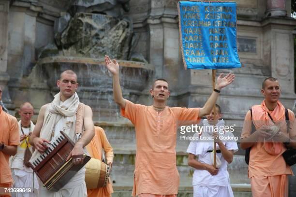 ISKCON devotees chanting and dancing in Paris. France.
