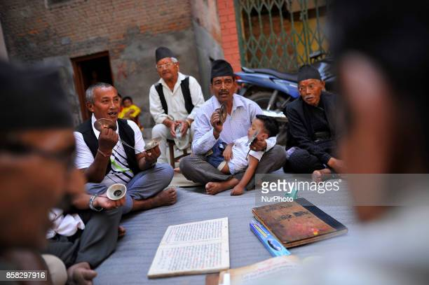 Devotees chanting traditional songs in a tunes of traditional instruments during Lord Narayan jatra festival in Hadigaun Kathmandu Nepal on Friday...