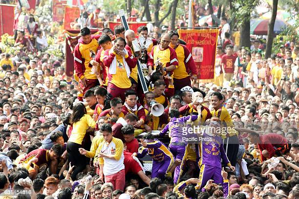 AVE MANILA NCR PHILIPPINES Devotees clamber over one another in an attempt to be able to touch the image of the Black Nazarene during the Traslacion...