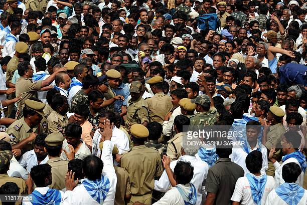 Devotees controlled by Police officials and volunteers wait to pay their last respects to Hindu guru Sathya Sai Baba outside Prashanthi Nilayam at...