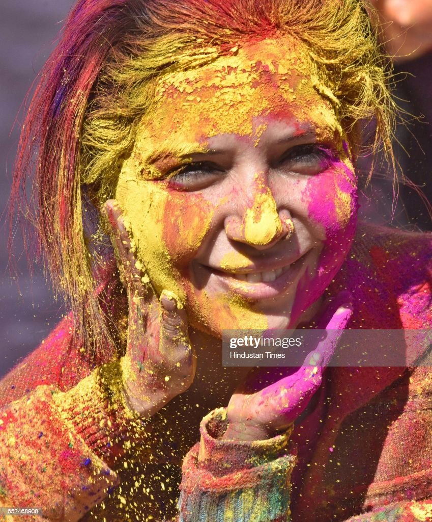 Devotees covered with Holi colour during the Holi celebration at the Durgiana Temple on March 12 2017 in Amritsar India Holi is a Hindu spring...