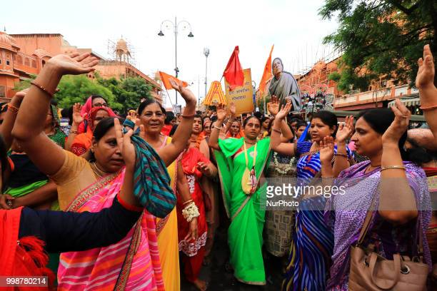 Devotees dance as others pull the chariots of Lord Jagannath during the 141st Rath Yatra at Shri Damodar Temple in Jaipur Rajasthan India on 14...