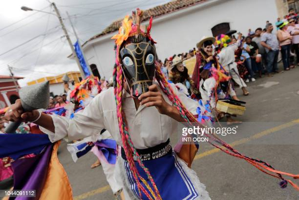 Devotees dance outside San Jeronimo Church during celebrations of San Jeronimo the patron saint of Masaya in Masaya some 30 km from Managua on...