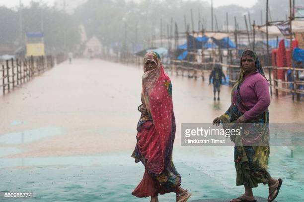 Devotees deals with the heavy rain due to Ochki cyclone as they come to pay tribute to Dr BR Ambedkar on his 61st mahaparinirvan diwas inside Dr...