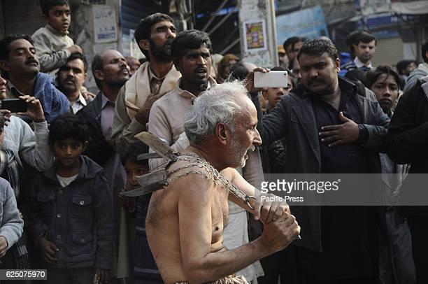 RAWALPINDI PUNJAB PAKISTAN Devotees doing selfflagellation during the procession Shiite Muslims take part in a procession marking Chehlum...