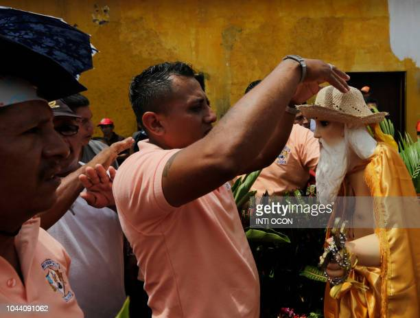 Devotees dress a replica of the image of San Jeronimo during celebrations of San Jeronimo the patron saint of Masaya in Masaya some 30 km from...
