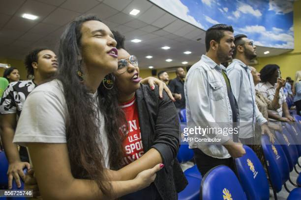 Devotees Elizabeth Cristina 24 and Anna Bomfim 26 participate in the Sunday service at the Contemporary Christian Church the first in the country to...
