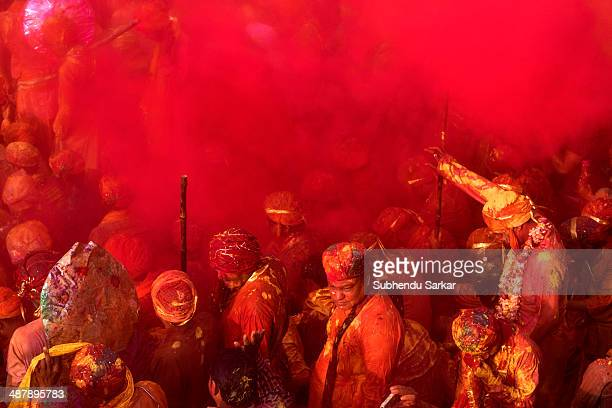 Devotees enjoy themselves at Krishna temple in Nandgaon on Holi when the atmosphere becomes electric as colours are sprayed from every direction...