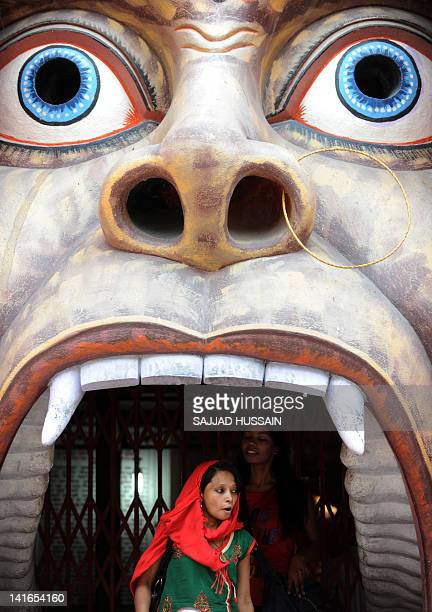 Devotees exit a temple of Hindu monkeygod Hanuman in New Delhi on March 21 2012 The highly popular monkeygod Hanuman known for his strength is...