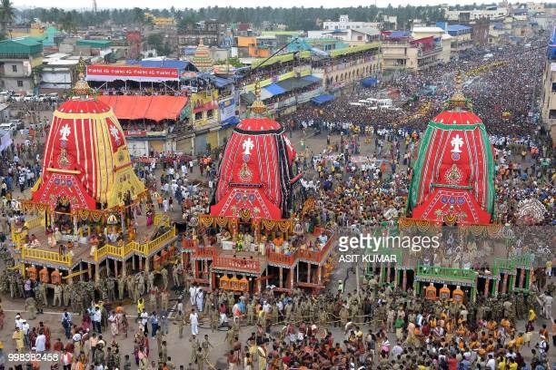 Devotees gather around chariots as they wait to pull them during the annual Hindu festival Rath Yatra or chariot procession in Puri on July 14 2018...