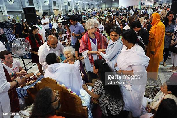 Devotees gather to embrace Mata Amritanandamayi also known as 'The Hugging Saint' on July 10 2012 in New York City The Hindu spiritual leader and...