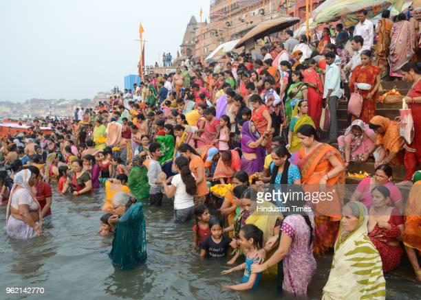 Devotees gather to take a holy dip in River Ganga on the occasion of 'Ganga Dussehra' at Sheetla Ghat on May 24 2018 in Varanasi India It is believed...