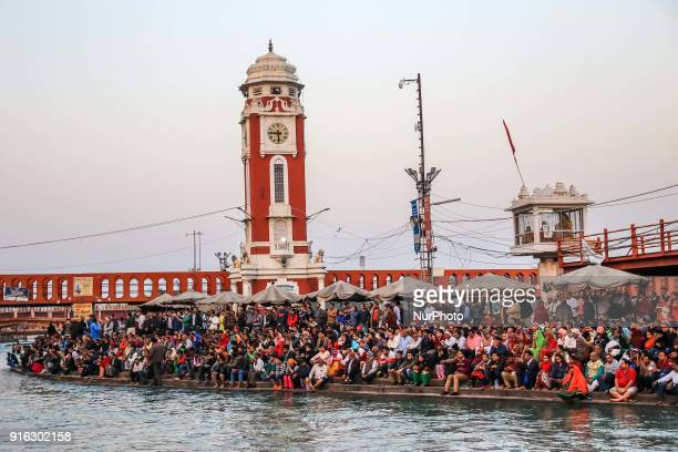 Devotees gathered to take part in Ganga river aarti ' Paryer' at Har ki Pauri in Haridwar Uttrakhand India on 8th Feb 2018 The priests perform...