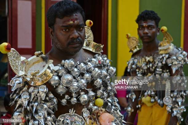 Devotees get their bodies pierced with lemon and 'Paaladai' or a utensil traditionally used to feed milk to infants, wait to take part in a religious...