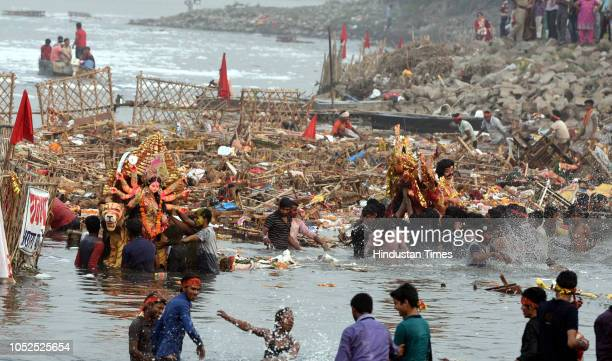 Devotees immerse idols of goddess Durga in Yamuna river at Kalindi Kunj after four day long Durga Puja on October 19 2018 in New Delhi India
