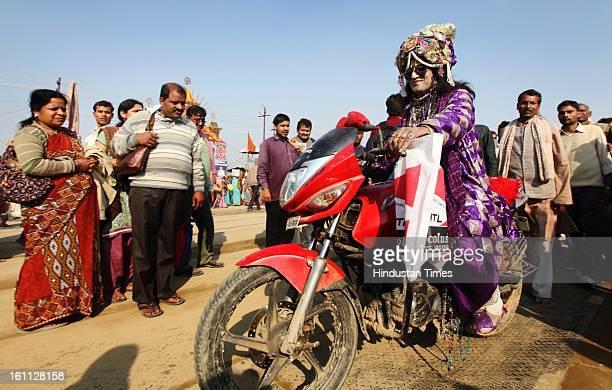 Devotees in the getup of Sri Krishan taking the ride on bike in Kumbh mela area on February 9, 2013 in Allahabad, India. The mega religious fair is...