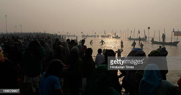 Devotees in the morning at the bank of Sangam confluence of river Ganga Yamnuna and mythical Saraswati on the occasion of Makar Sankranti on January...