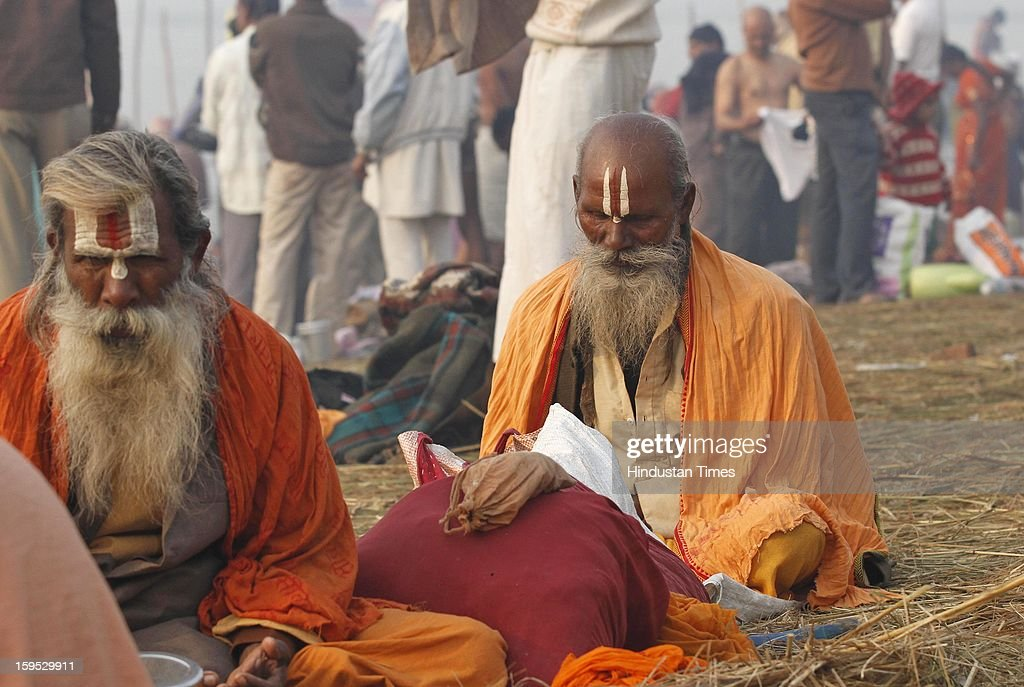 Devotees in the morning at the bank of Sangam confluence of river Ganga, Yamnuna and mythical Saraswati on the occasion of Makar Sankranti on January 15, 2013 in Allahabad, India. Kumbh is World's biggest religious gathering, in which more than 100 million of Hindus and sikh devotees will take part over next 55 days. Apart from being pilgrimage of faith, salvation and hope for millions of devotees, it also serve as meeting ground for the vast spectrum of Indian religious and spiritual views.