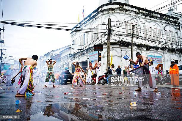 CONTENT] Devotees in trances slashing themselves with axes machete and knives at a street junctions during 2011 Phuket Vegetarian festivals