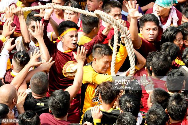 AVE MANILA NCR PHILIPPINES Devotees jostle among themselves to be able to even just briefly touch the abacca rope pulling the andas of the Black...