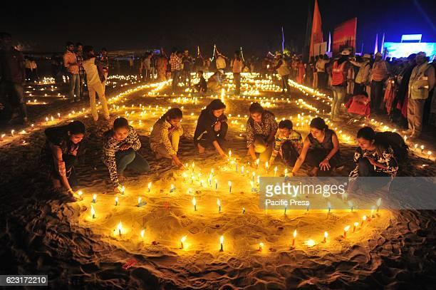 Devotees light candles on the occasion of Kartik Purnima also called Ganga Dussehra festival at Sangam the confluence of River Ganga Yamuna and...