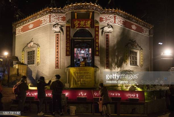 Devotees light up incenses before entering the Lin Fa Kung temple during the Kwun Yum Treasury festival in Hong Kong China on February 18 2020...