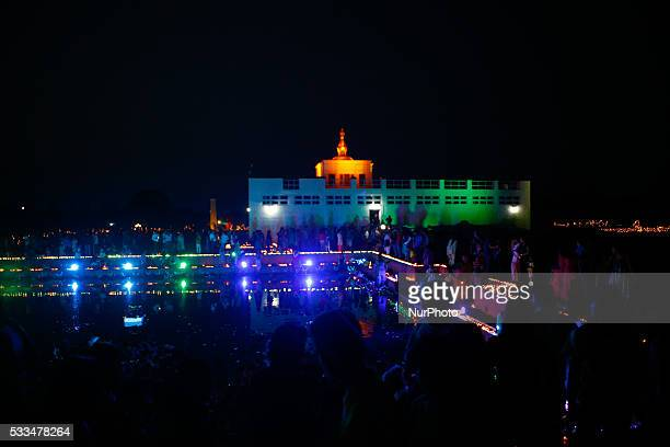 Devotees lights candle to offer their prayer at the Maya Devi temple during the celebrations marking 2560th Buddha Jayanti or Buddhas birthday at...