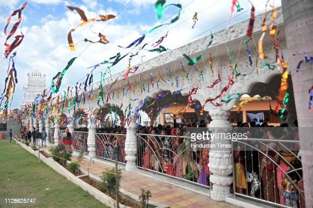 Devotees line up to offer prayers at Aap Shambhu a temple of lord Shiva during Mahashivratri festival on March 4 2019 in Jammu India Temples and...