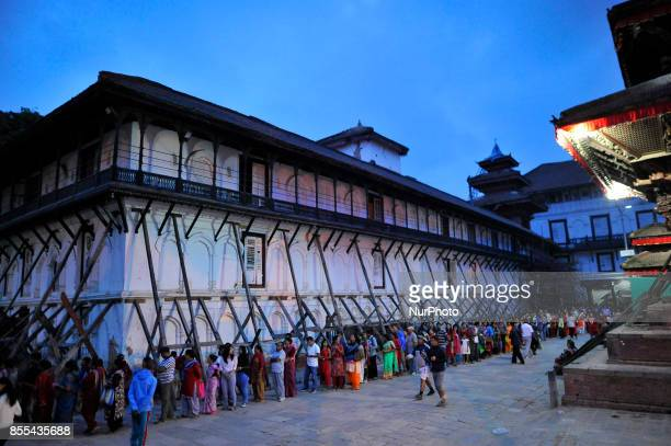 Devotees lining on Taleju Temple to pay respect towards goddess on the occasion of Navami ninth day of Dashain Festival at Basantapur Durbar Square...