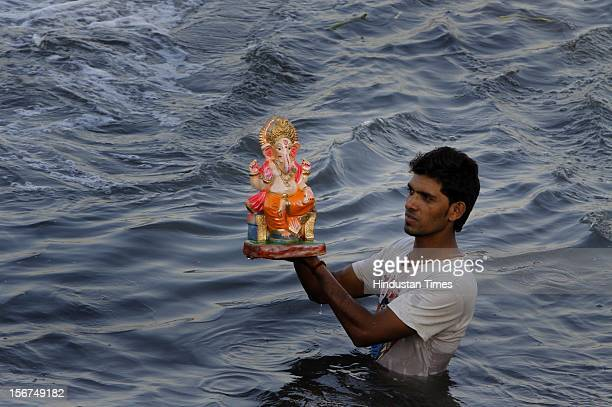 NEW DELHI INDIA SEPTEMBER 29 Devotees Lord Ganesh Visarjan at Ganesh Mahotsav at river Yamuna on September 29 2012 in New Delhi India