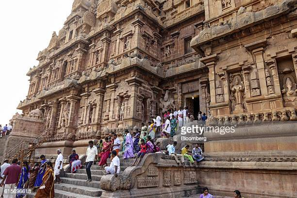 Devotees make their way down a flight of stairs at the Brihadeshwara Temple in Thanjavur Tamil Nadu India on Sunday Oct 16 2016 India's new central...