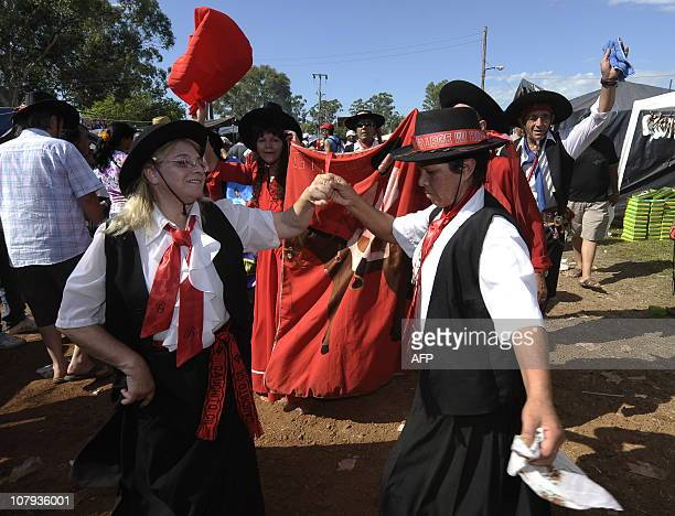 Devotees of folk saint Gauchito Gil dance chamame to honour him near Mercedes in the Argentine province of Corrientes on January 8 2011 The cult of...