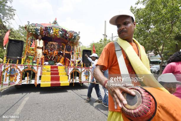 Devotees of Lord Krishna take out a procession of Lord Jagannath Ratha Yatra chanting Hare Krishna Maha Mantra at Sushant Lok on June 25 2017 in...
