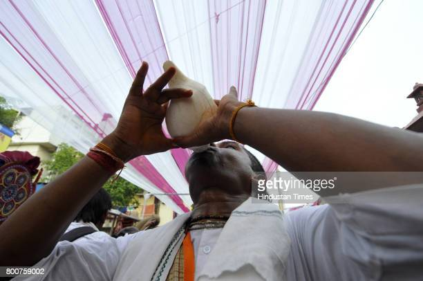 Devotees of Lord Krishna take out a procession of Lord Jagannath Ratha Yatra chanting Hare Krishna Maha Mantra on June 25 2017 in Noida India Ratha...